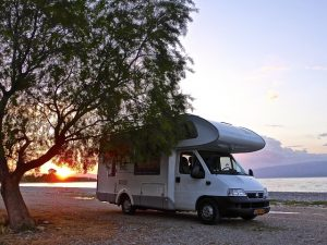 Motorhome on the beach at sunset